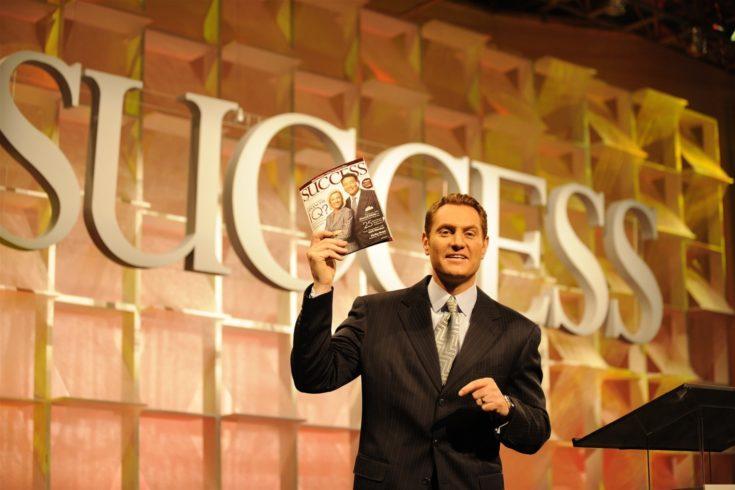 Darren Hardy holding Success Magazine on stage