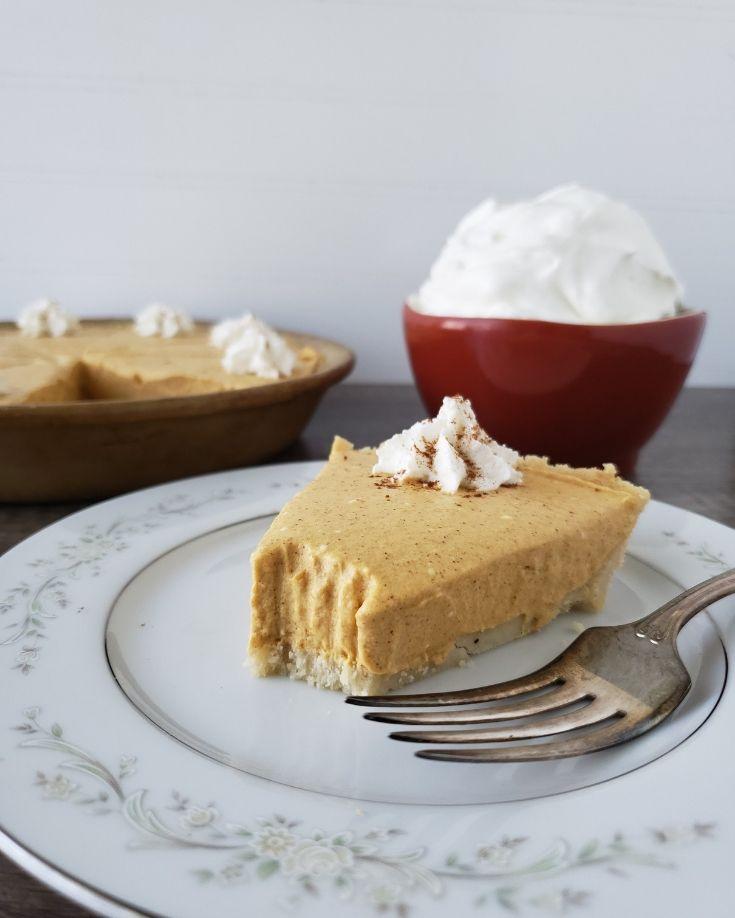 plated slice of pumpkin pie