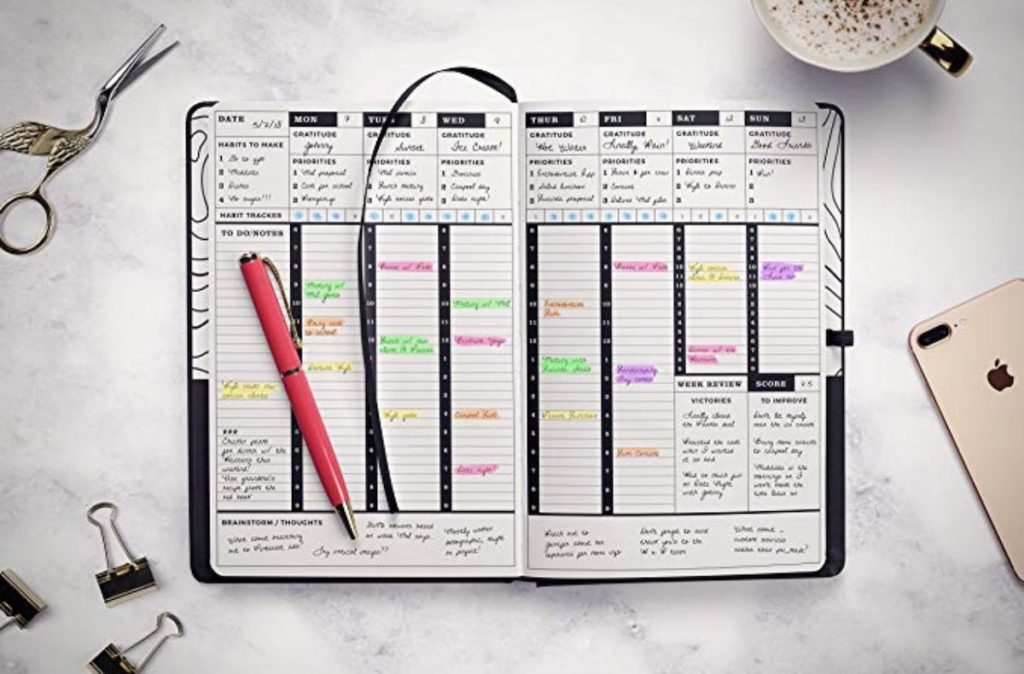 A planner open where you can see schedule