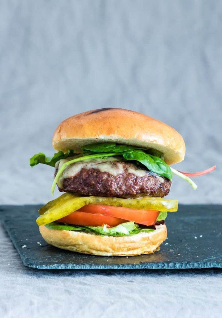 Juicy Air Fryer Hamburger with veggies and a bun