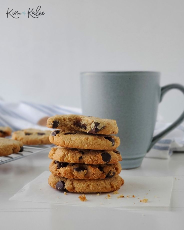 5 Low Carb Chocolate Chip Cookies with a Mug Behind Them