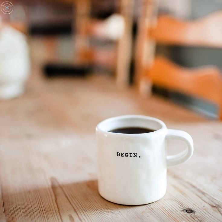 picture of a coffee mug that says begin