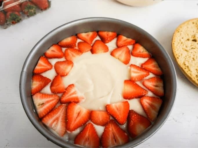 layering your Strawberry Shortcake Cheesecake