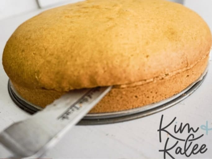 creating 2 thin layers of cake with a knife