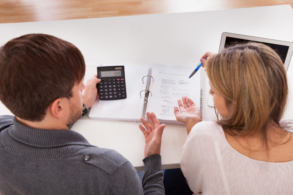 couple looking over their budget categories