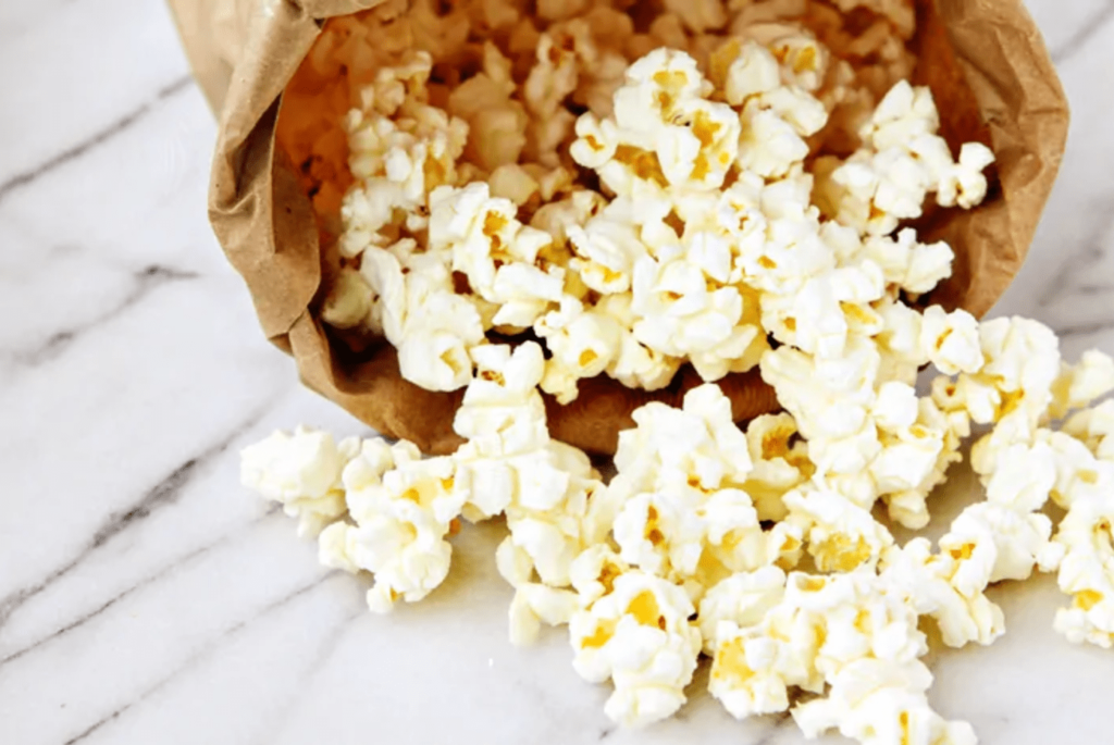 homemade popcorn in a paper bag