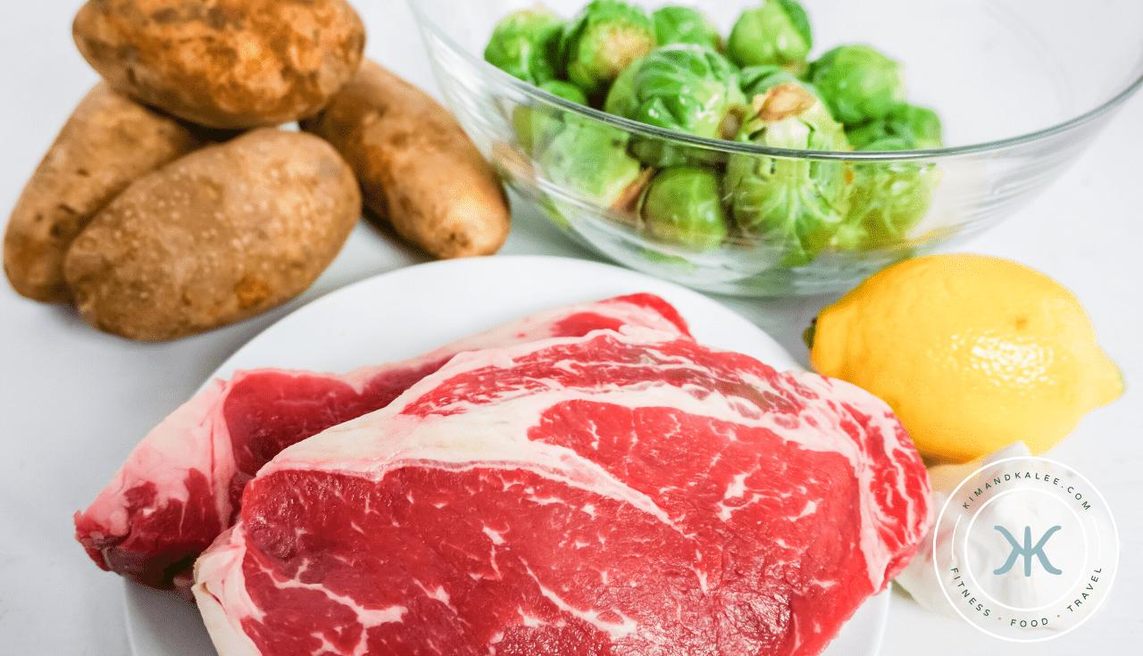 Making garlic steak and potato foil packs