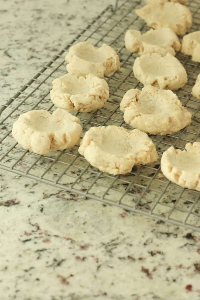 making thumbprint cookies with pecans