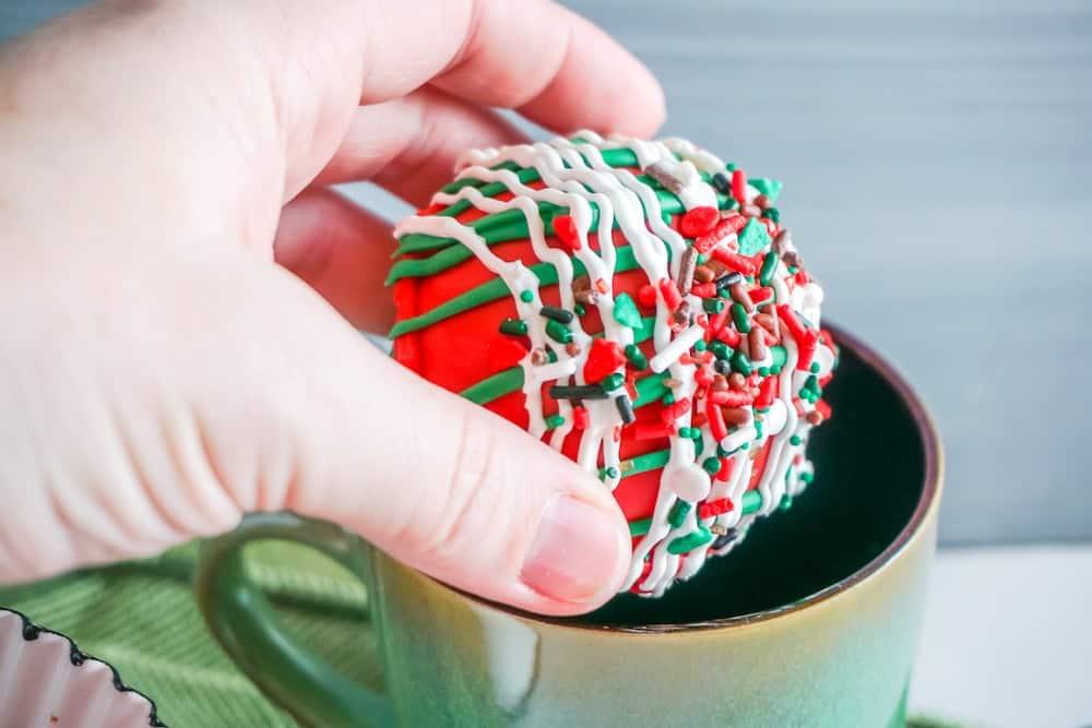 Christmas Hot Chocolate Bombs about to go into a mug
