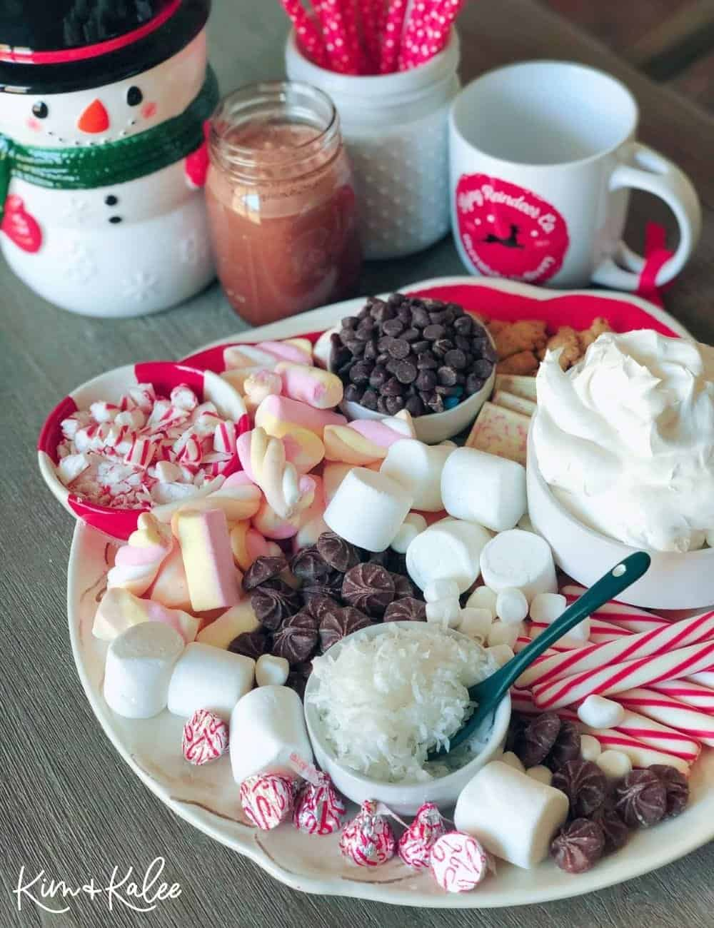How to Make a Hot Chocolate Charcuterie Board with a snowman, mugs, and straws