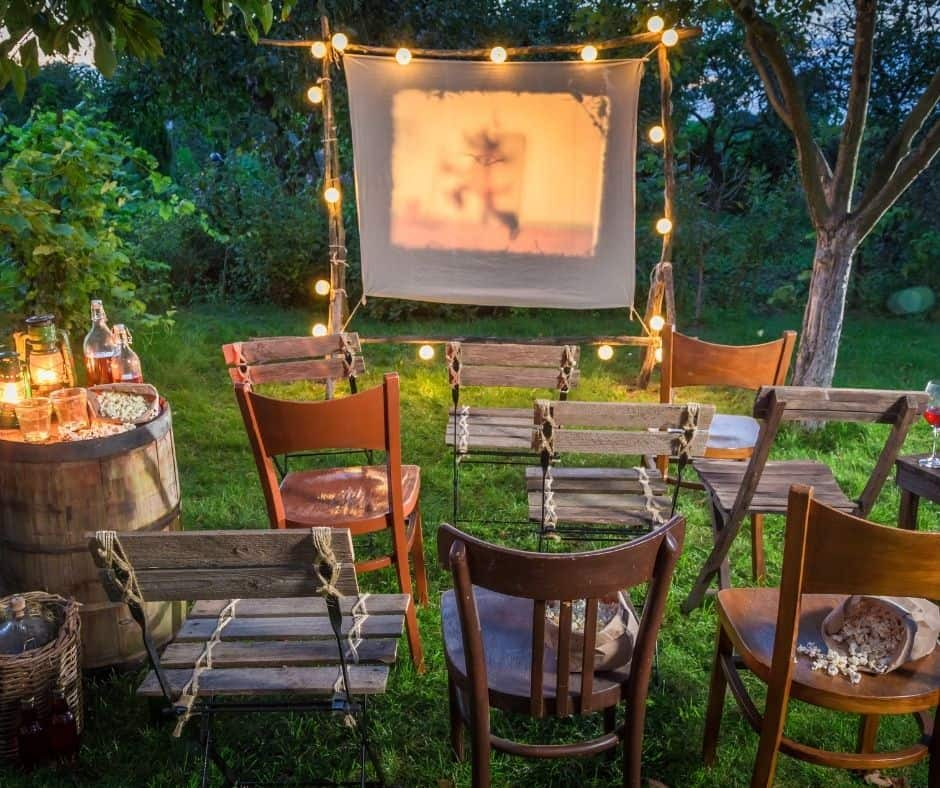 outdoor movie night with a screen and chairs