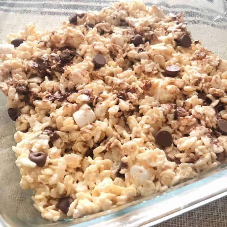 the dish of rice krispie treats with chocolate chips and marshmallows