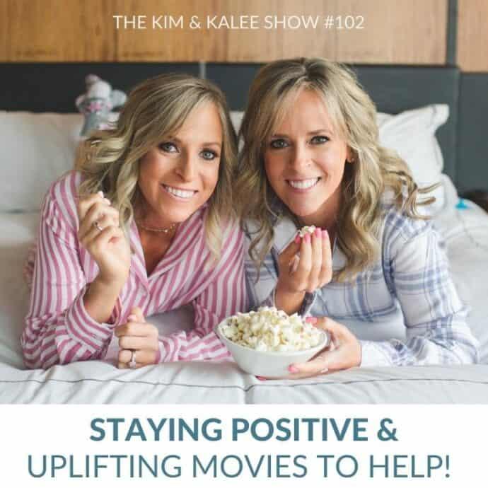Kalee & Kim laying on bed eating popcorn