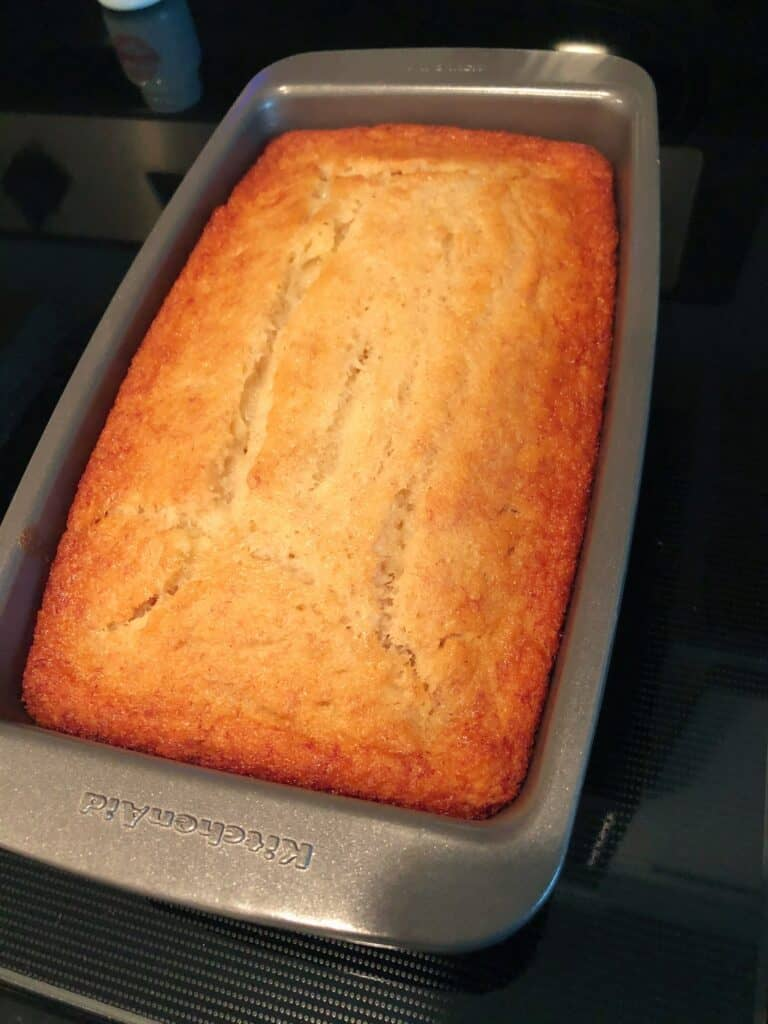 banana bread out of the oven in loaf pan