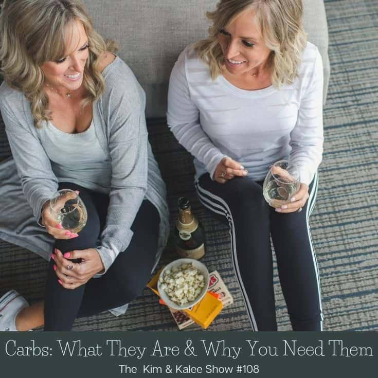 Kim & Kalee sitting on floor with candy & bubbly