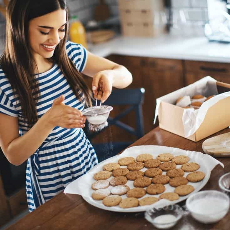 woman making cookies for a care package for boyfriend