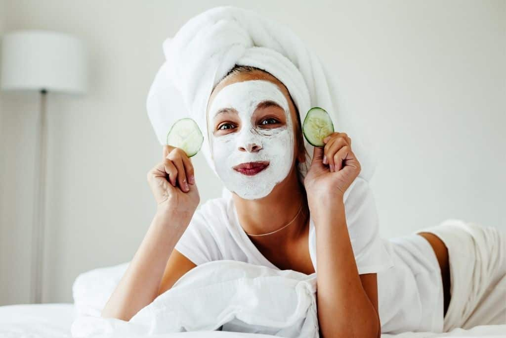 girl with a facial mask on for a spa day