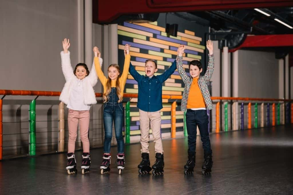 kids at a skating rink for a 10th birthday party idea