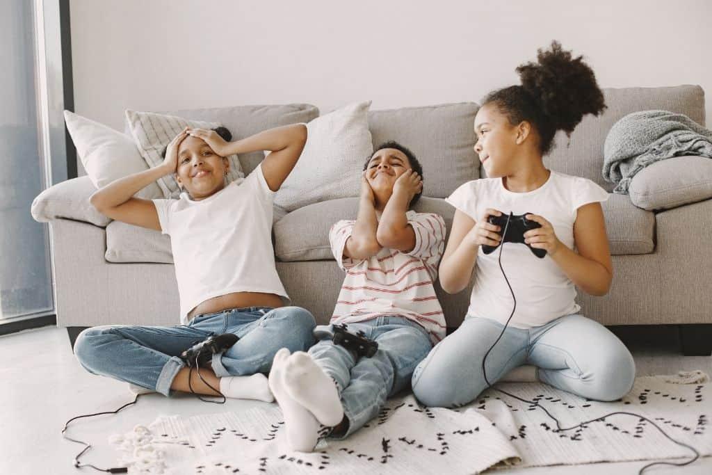 3 kids playing video games