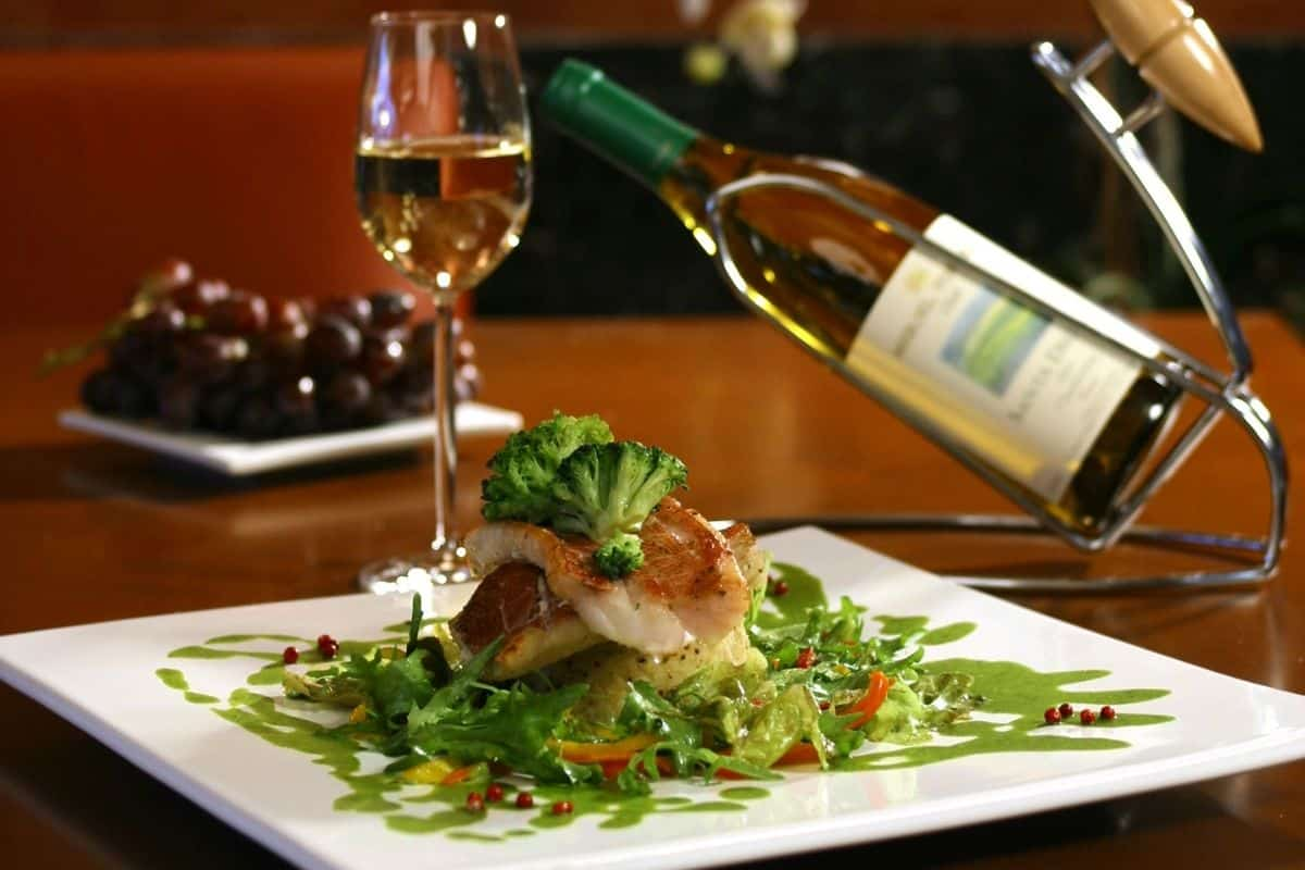 nice restaurant food on a plate with wine