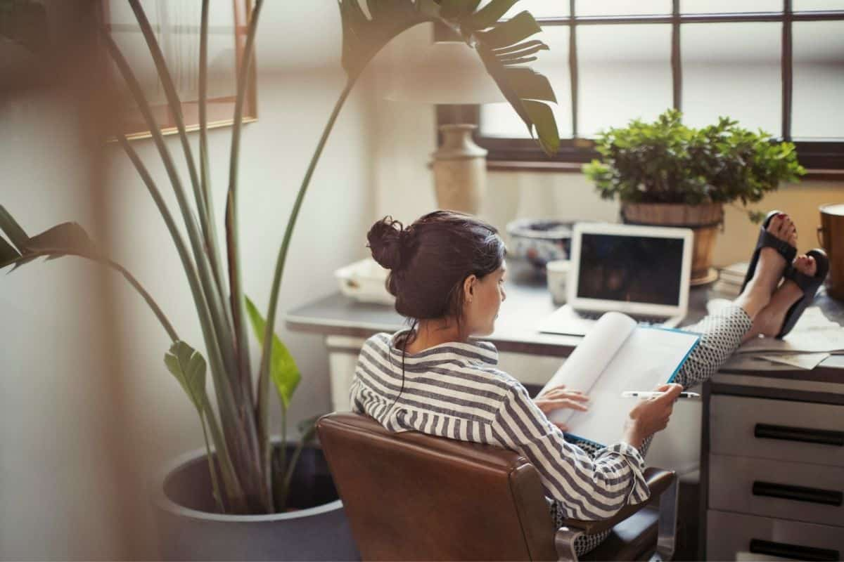 woman working from home with feet up on the desk
